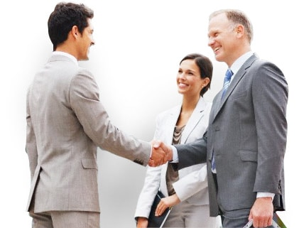 Two businessmen shake hands while businesswoman watches.